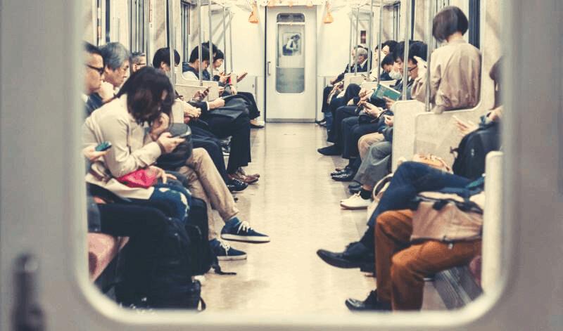 People looking at phone on metro
