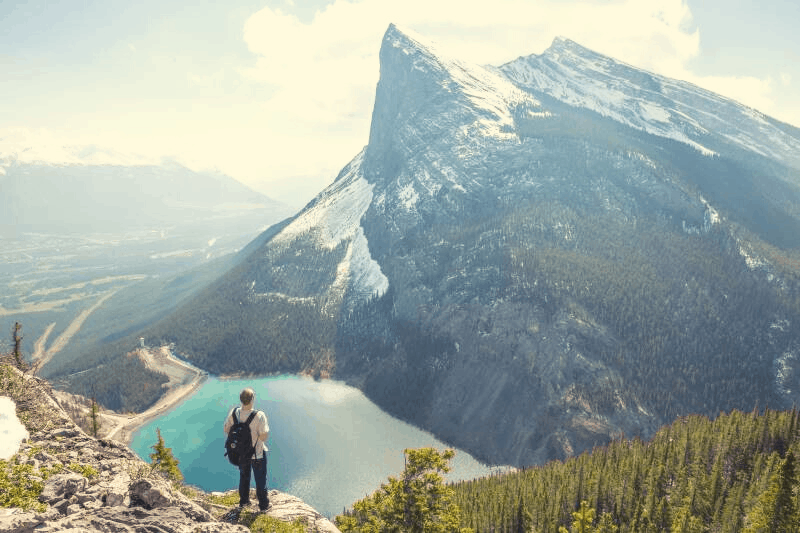 a man staring in silence at a mountain