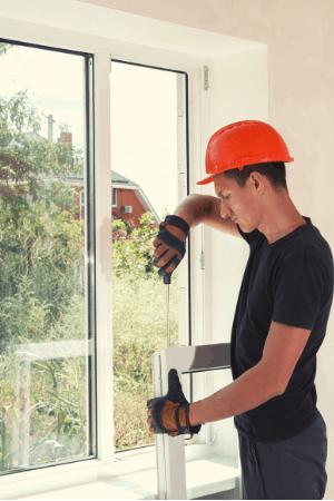 A man installing a window