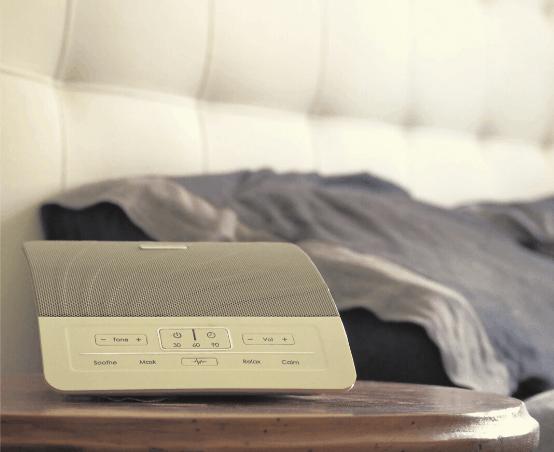 White noise machine next to bed