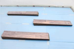 Piles of woodfloor on blue underlay