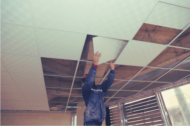 Installation of ceiling tiles on a suspended ceiling